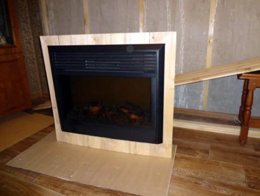 обрамление электрокамина дрвесными материалами